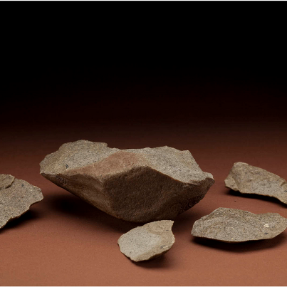 Stone core and flake from Lokalalei, Kenya, about 2.3 million years old. Image courtesy of the Smithsonian Institution