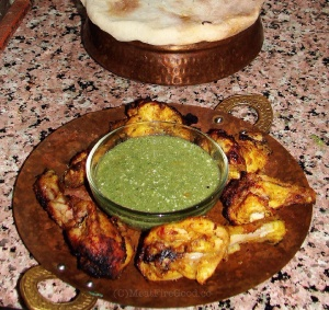 Fire-roasted Butter Chicken served with a cilantro-lime chutney.